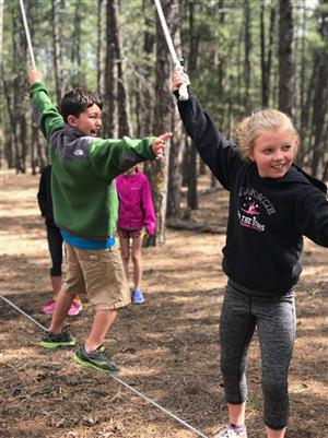 D49 students learn teamwork during a ropes course challenge in Black Forest